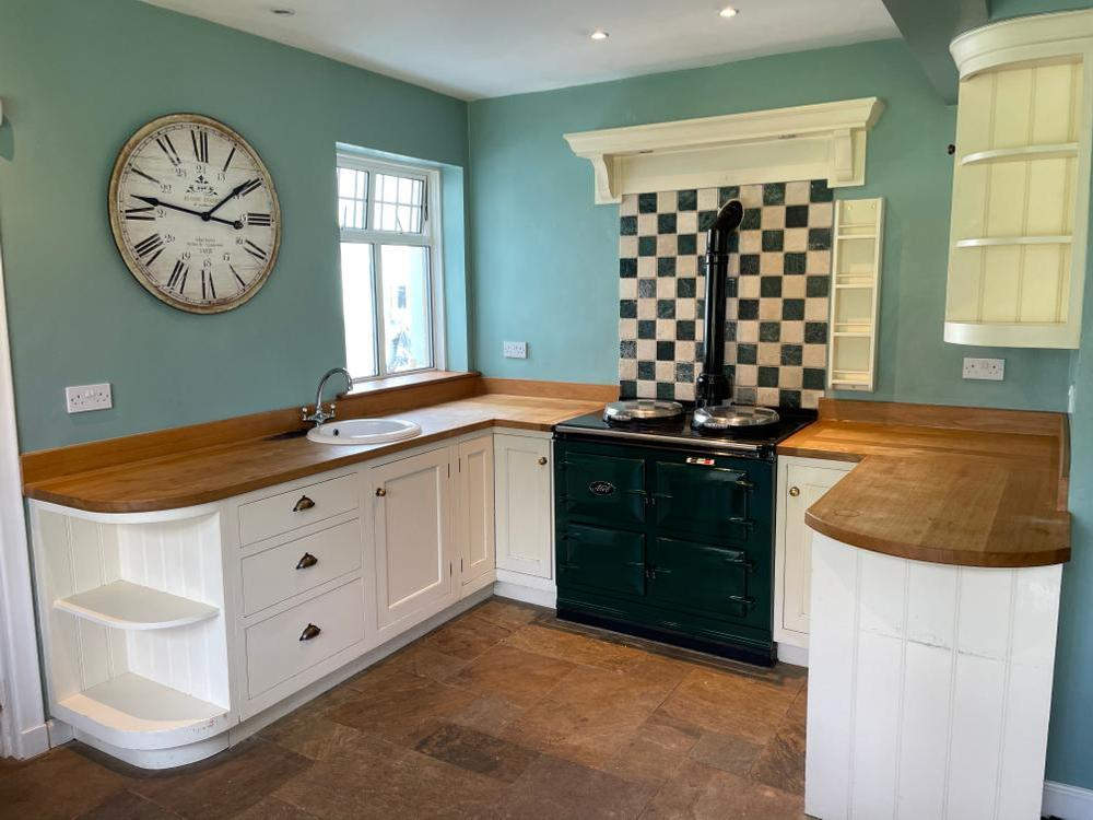 Kitchen by Murray & Murray with Oak Worktops