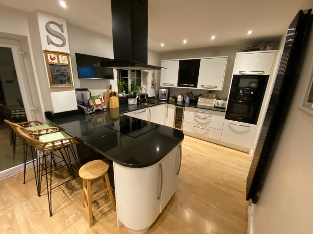 Modern White Kitchen with Granite & Appliances Located in Leeds
