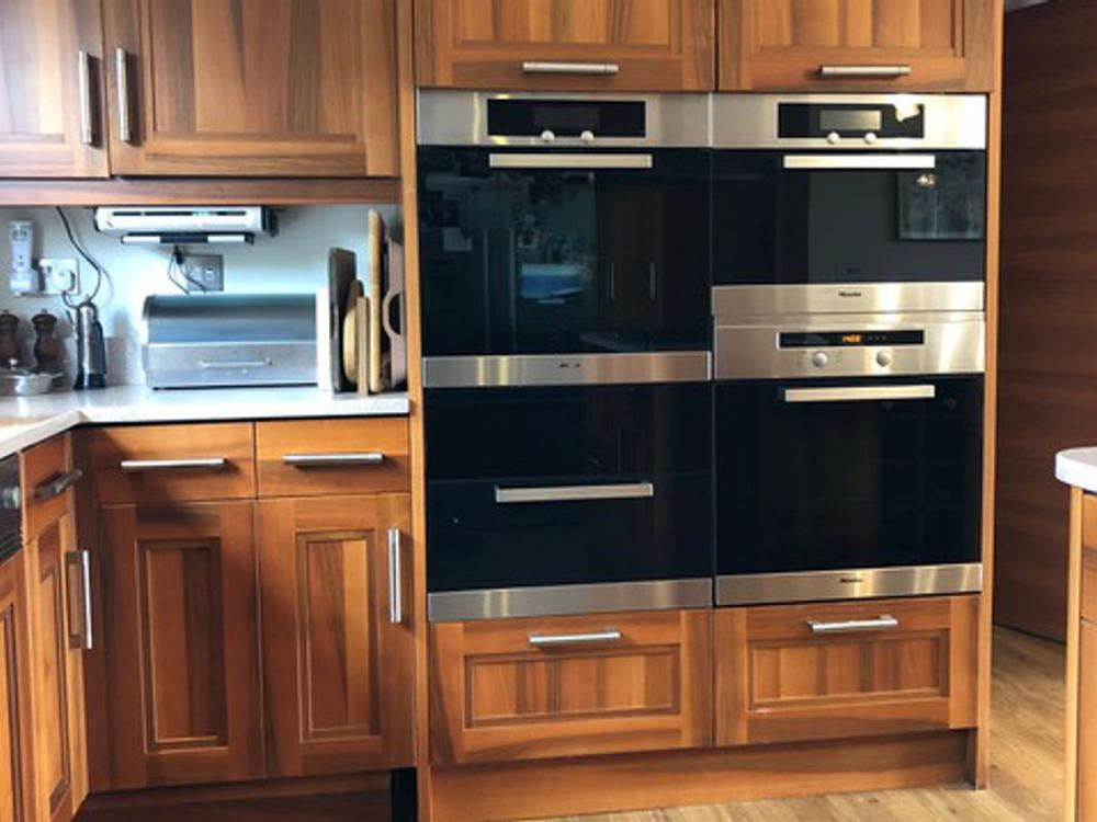 Wallnut Kitchen with Miele Appliances & Granite Worktops